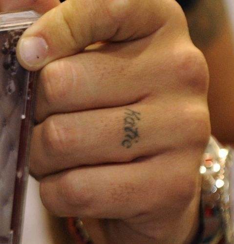 Peter andre tattoos bodypaintzone for Finger tattoo cost